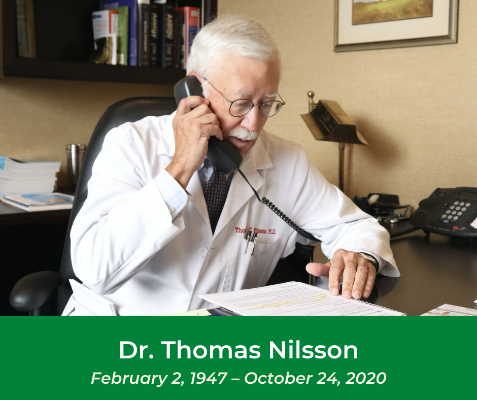 Dr. Nilsson answering the phone in his medical office